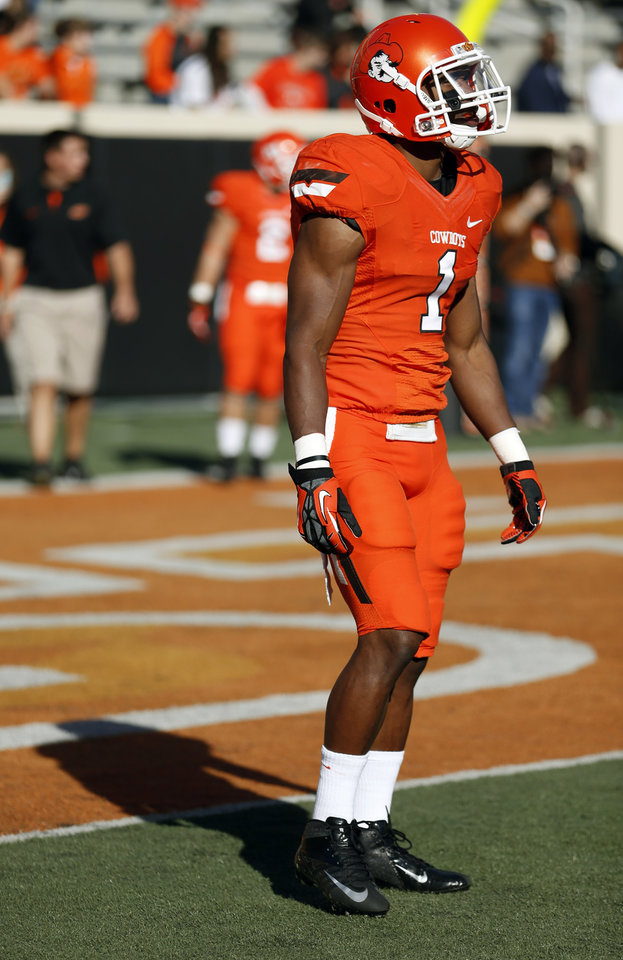 Photo - Oklahoma State's Joseph Randle (1) warms up before a college football game between Oklahoma State University (OSU) and Iowa State University (ISU) at Boone Pickens Stadium in Stillwater, Okla., Saturday, Oct. 20, 2012. Photo by Sarah Phipps, The Oklahoman