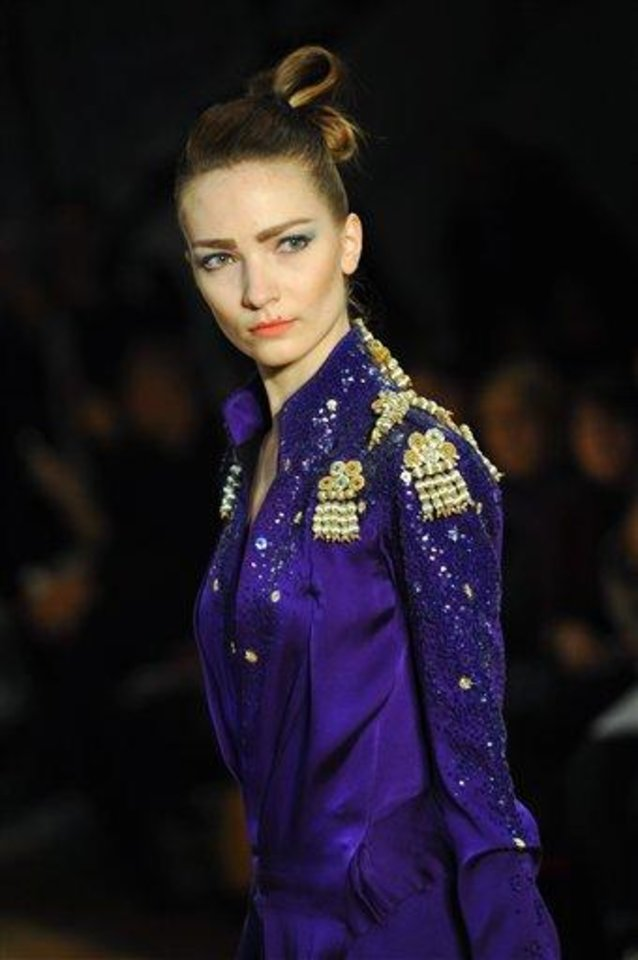 A model wears a creation by fashion designer Gustavo Lins as part of his Spring/Summer 2013 Haute Couture fashion collection, in Paris, Tuesday, Jan. 22, 2013. (AP Photo/Zacharie Scheurer)
