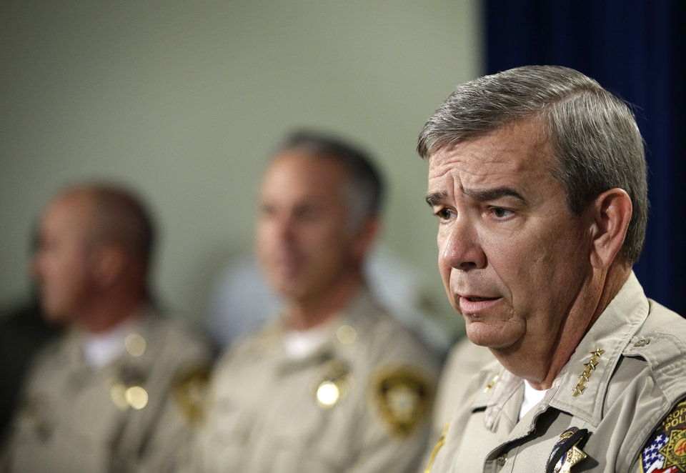 Photo - Las Vegas Sheriff Doug Gillespie speaks during a news conference, Monday, June 9, 2014, in Las Vegas. Police say two police officers, along with a bystander, were killed by suspects Jerad and Amanda Miller yesterday. (AP Photo/John Locher)