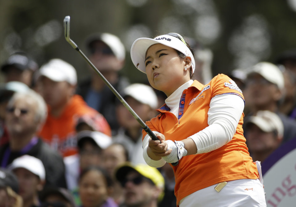 Photo - Jenny Shin follows her shot from the third tee of Lake Merced Golf Club during the final round of the Swinging Skirts LPGA Classic golf tournament on Sunday, April 27, 2014, in Daly City, Calif. (AP Photo/Eric Risberg)