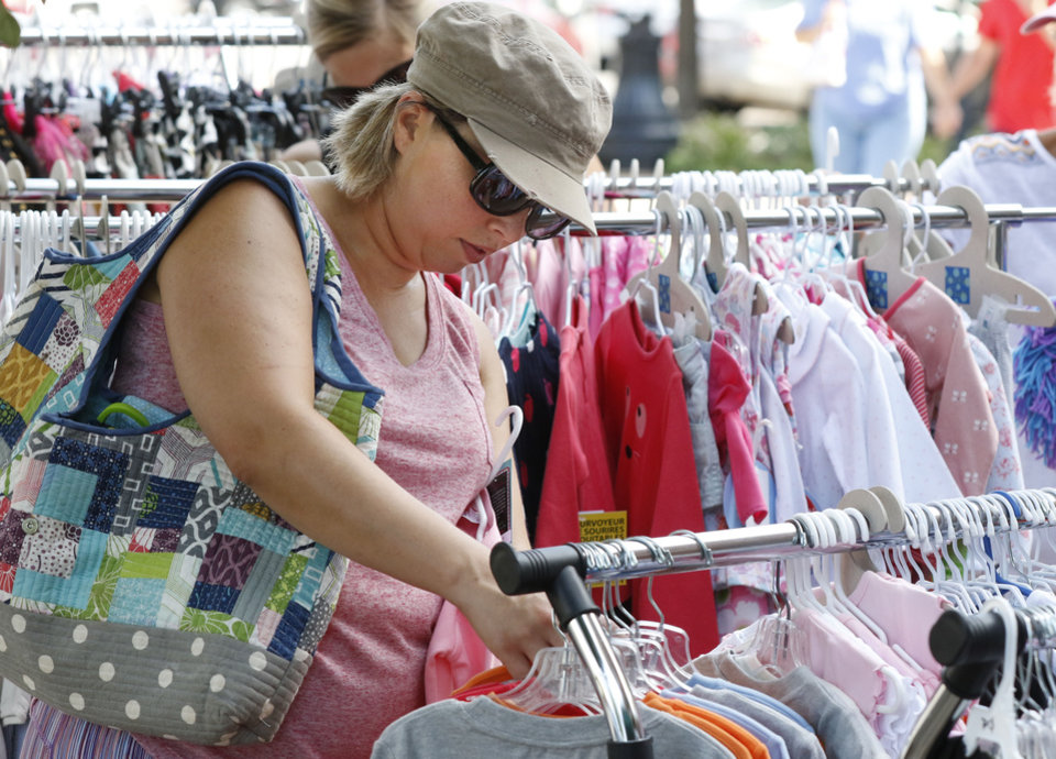 Photo -  Liz Taylor looks through sale items at Cinnamon Bears during the Krazy Daze event in downtown Edmond. [PHOTO BY PAUL HELLSTERN, THE OKLAHOMAN]