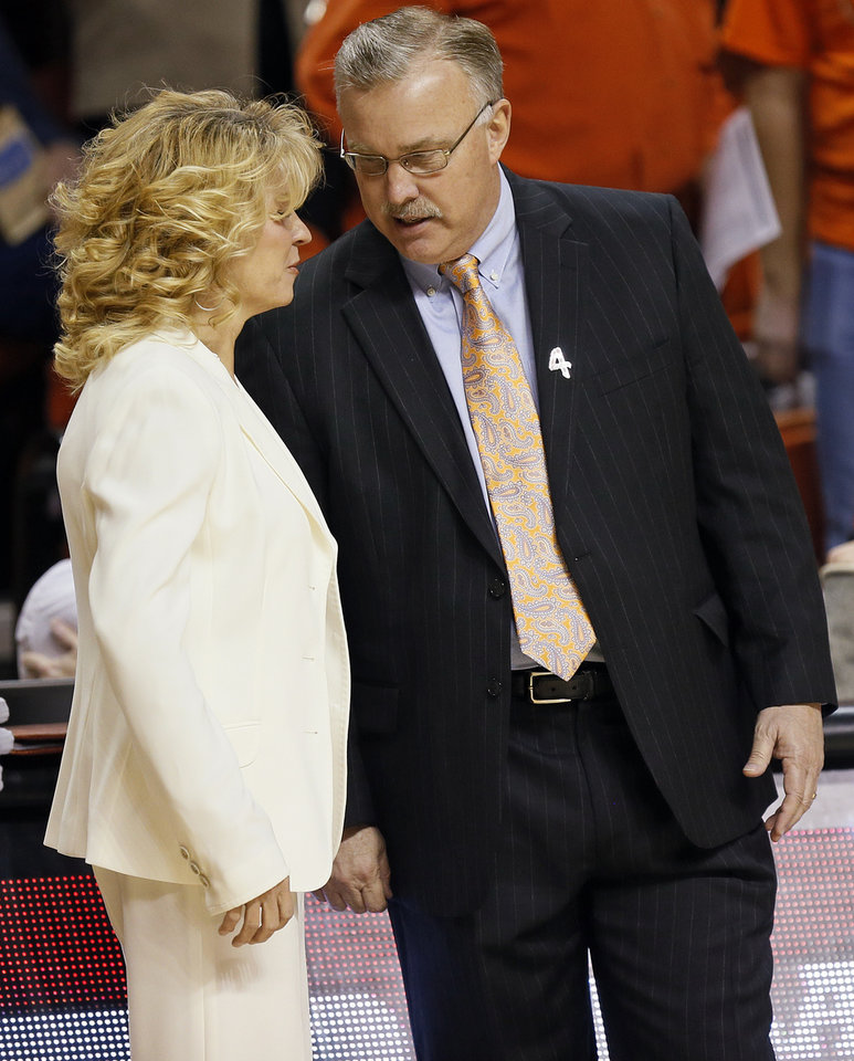 Photo - OU head coach Sherri Coale and OSU head coach Jim Littell talk before the Bedlam women's college basketball game between Oklahoma State University (OSU) and the University of Oklahoma (OU) at Gallagher-Iba Arena in Stillwater, Okla., Saturday, Feb. 23, 2013. Photo by Nate Billings, The Oklahoman