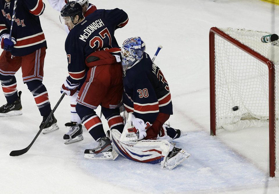 Photo - New York Rangers goalie Henrik Lundqvist (30), of Sweden, is blocked by teammate Ryan McDonagh (27) as a shot from Montreal Canadiens' Max Pacioretty gets past him for a goal during the second period of an NHL hockey game, Tuesday, Feb. 19, 2013, in New York. (AP Photo/Frank Franklin II)