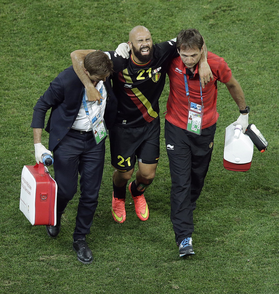 Photo - Belgium's Anthony Vanden Borre is carried off the field after being injured during the group H World Cup soccer match between South Korea and Belgium at the Itaquerao Stadium in Sao Paulo, Brazil, Thursday, June 26, 2014. Belgium won 1-0. (AP Photo/Andrew Medichini)
