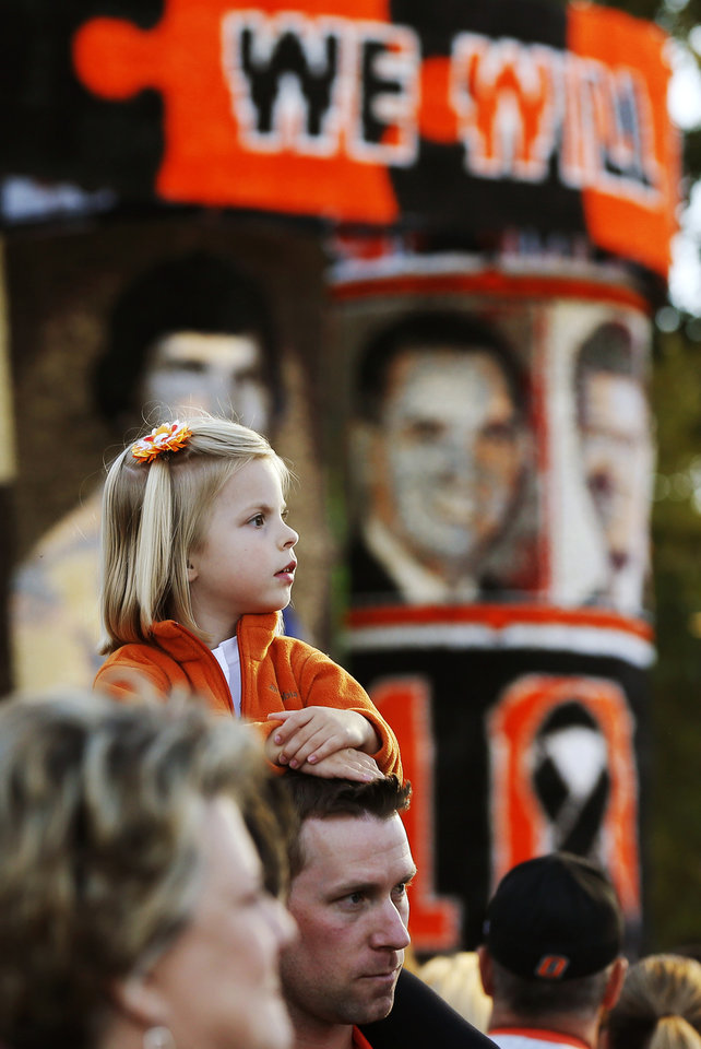 Hannah Wolfe, 4, of Edmond, Okla., sits on the shoulders of her father, Chad Wolfe, an OSU alumnus,  near the Alpha Gamma Rho/Chi Omega house decoration during Walkaround at Oklahoma State University's homecoming in Stillwater, Okla., Friday, Oct. 19, 2012. Photo by Nate Billings, The Oklahoman