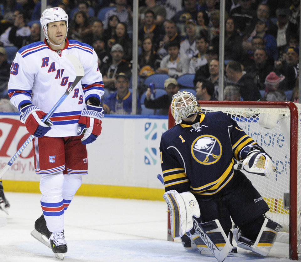 Photo - New York Rangers' Ryane Clowe (29) and Buffalo Sabres' Jhonas Enroth (1) react after a goal by Rick Nash (not shown) during the second period of an NHL hockey game in Buffalo, N.Y., Friday, April 19, 2013. (AP Photo/Gary Wiepert)