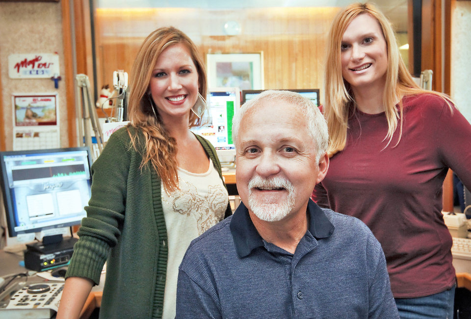 KMGL's radio personalities Jessi Stone, Steve O'Brien and Jennifer Leigh, from left, are in the studio Tuesday in Oklahoma City. The station has begun its 24-hour Christmas music programming.  Photo by Chris Landsberger, The Oklahoman