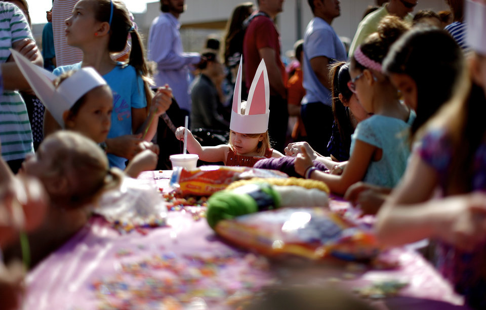 Layla Parish, 3, of Shawnee, sits at a crafts table with other children during the Myriad Gardens Annual Easter Egg Hunt in downtown Oklahoma City, Saturday, March 30, 2013. Photo by Bryan Terry, The Oklahoman