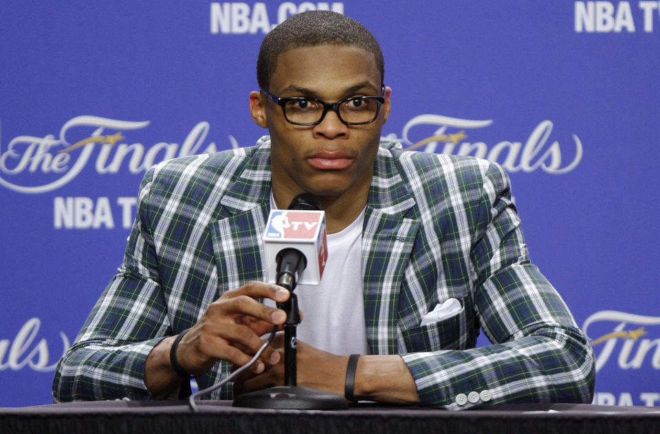 Photo - Oklahoma City's Russell Westbrook listens to a question during a press conference after Game 4 of the NBA Finals between the Oklahoma City Thunder and the Miami Heat at American Airlines Arena, Tuesday, June 19, 2012. Oklahoma City lost 104-98.  Photo by Bryan Terry, The Oklahoman