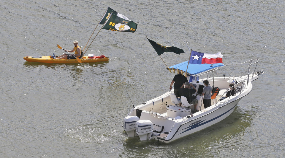 Photo - Fans float on the Brazos River outside the new McLane Stadium before an NCAA college football game between SMU and Baylor Sunday, Aug. 31, 2014, in Waco, Texas. (AP Photo/LM Otero)