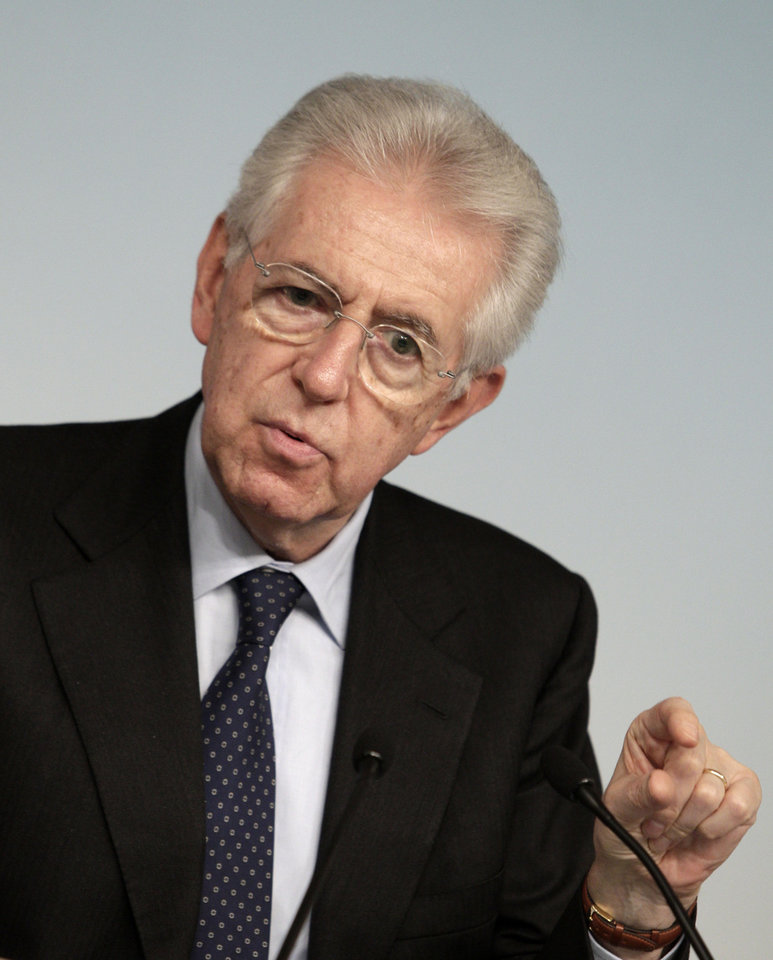 Photo - Italian Premier Mario Monti gestures during a press conference at the end of a cabinet meeting at Chigi Palace government's office in Rome, Thursday, Dec. 6, 2012. Concerns over the stability of the Italian government grew on Thursday after Silvio Berlusconi's party withdrew its support, threatening to bring a premature end to Premier Mario Monti's ambitious reforms program. Berlusconi's center-right PDL party abstained from a confidence vote in the Senate on Thursday. Though Monti's government of unelected technocrats won the vote by 127 to 17, investors fear the move heralds a period of political uncertainty in the run-up to planned elections next year. (AP Photo / Riccardo De Luca)