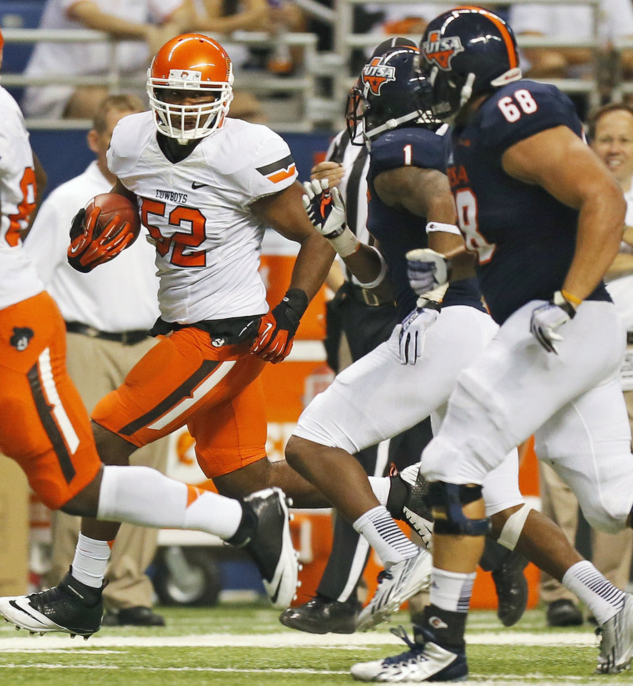 Photo - OSU's Ryan Simmons (52) runs from UTSA's Kam Jones (1) and Cody Harris (68) after intercepting the ball in the second quarter during a college football game between the University of Texas at San Antonio Roadrunners (UTSA) and the Oklahoma State University Cowboys (OSU) at the Alamodome in San Antonio, Saturday, Sept. 7, 2013.  Photo by Nate Billings, The Oklahoman