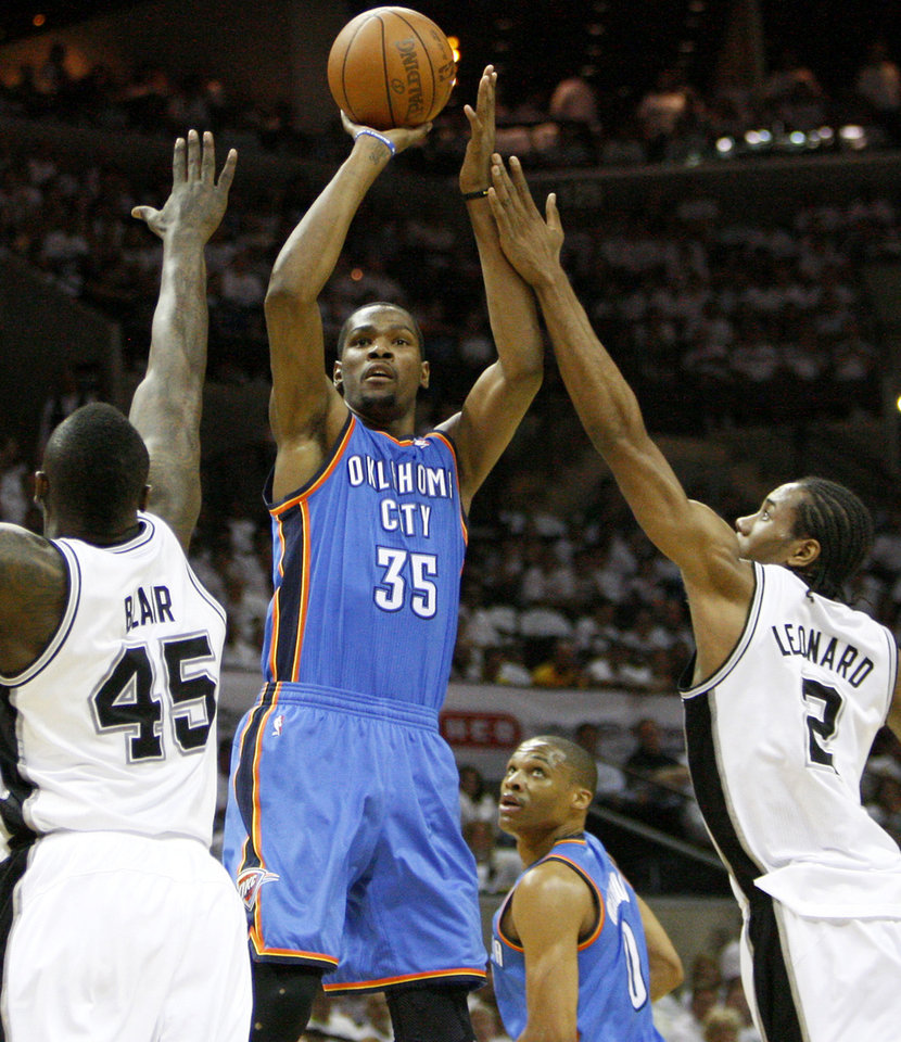 Photo - Oklahoma City's Kevin Durant (35) shoots the ball between San Antonio's DeJuan Blair (45) and Kawhi Leonard (2) during Game 5 of the Western Conference Finals between the Oklahoma City Thunder and the San Antonio Spurs in the NBA basketball playoffs at the AT&T Center in San Antonio, Monday, June 4, 2012. Photo by Nate Billings, The Oklahoman