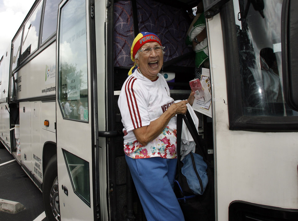 Alicia Amador boards one of fifty buses traveling to New Orleans from Miami to vote in the Venezuelan election Saturday Oct. 6th, 2012. The Venezuelan government closed the down its consulate in Miami where the largest population of Venezuelans reside in the United States.(AP Photo/Jeffrey M. Boan)