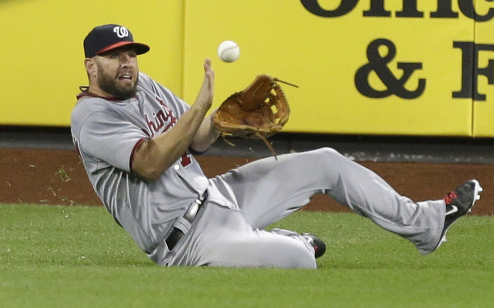 Photo - Washington Nationals left fielder Kevin Frandsen catches a ball hit by New York Mets' David Wright for an out to end the sixth inning of a baseball game Wednesday, Aug. 13, 2014, in New York.  (AP Photo/Frank Franklin II)