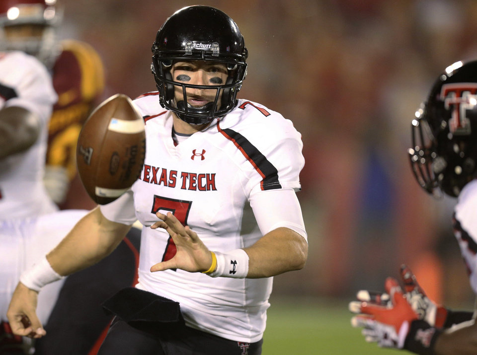 Texas Tech quarterback Seth Doege (7) flips the ball to wide receiver SaDale Foster, right, during the second half of an NCAA college football game against Iowa State, Saturday, Sept. 29, 2012, in Ames, Iowa. Texas Tech won 24-13. (AP Photo/Justin Hayworth)
