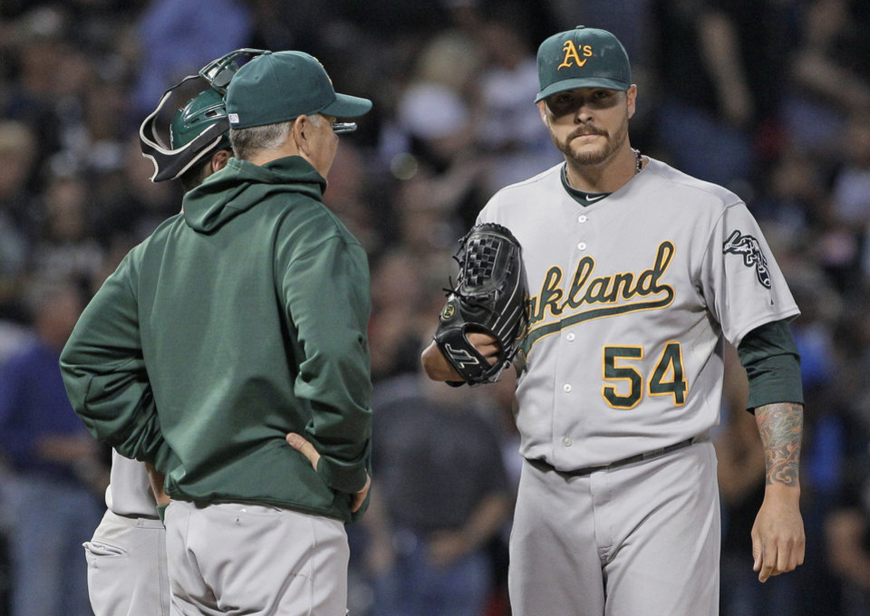 Photo -   Oakland Athletics starter Travis Blackley, right, listens to pitching coach Curt Young during the fifth inning of a baseball game against the Chicago White Sox in Chicago, Saturday, Aug. 11, 2012. (AP Photo/Nam Y. Huh)