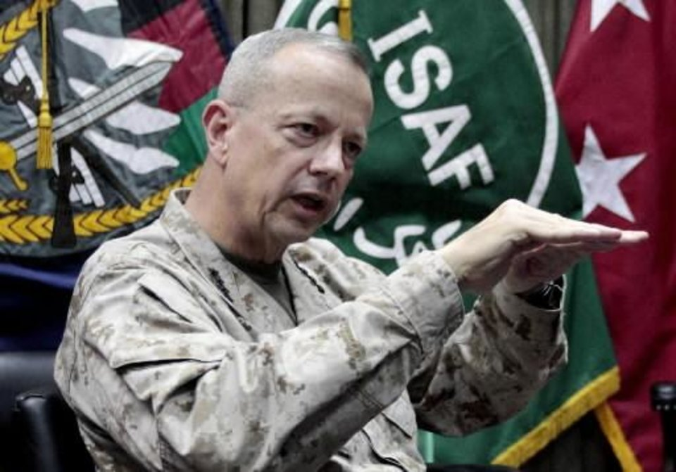 "FILE - This July 22, 2012, file photo shows U.S. Gen. John Allen, top commander of the NATO-led International Security Assistance Forces (ISAF) and U.S. forces in Afghanistan, during an interview with The Associated Press in Kabul, Afghanistan. The Pentagon says Gen. John Allen is under investigation for alleged ""inappropriate communications"" with Jill Kelley, the woman who is said to have received threatening emails from Paula Broadwell, the woman with whom former CIA Director David Petraeus had an extramarital affair. Defense Secretary Leon Panetta says the FBI referred the matter to the Pentagon on Sunday, Nov. 11, 2012. Panetta says he ordered a Pentagon investigation of Allen on Monday. (AP Photo/Musadeq Sadeq, File) ORG XMIT: NY107"
