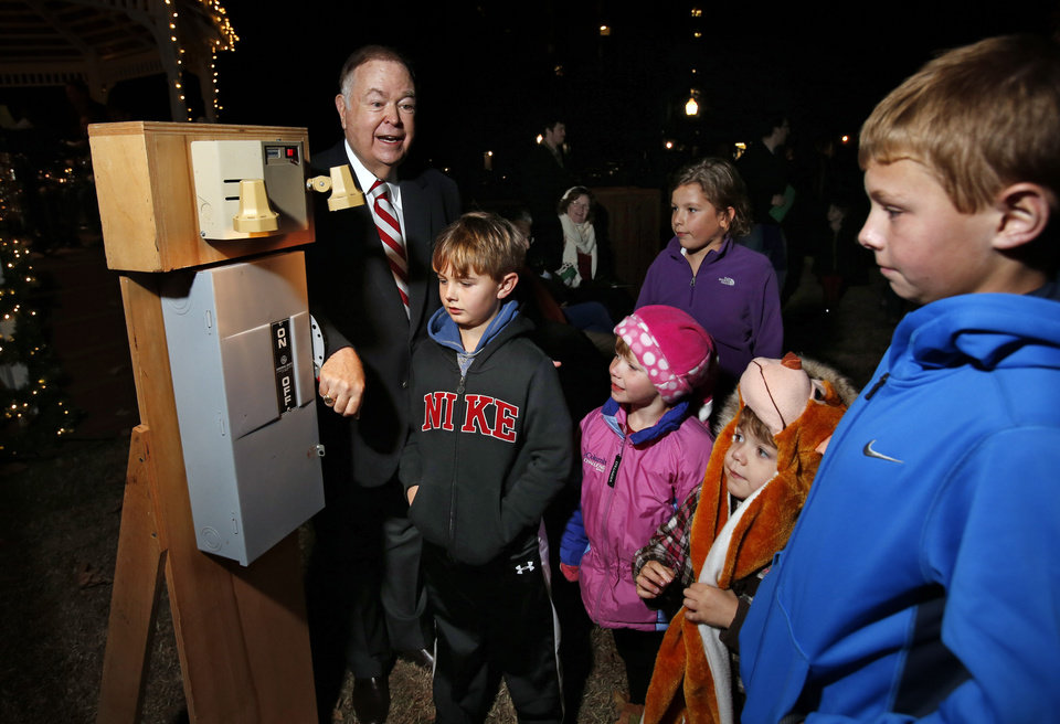 President David L. Boren throws the switch to light a Christmas tree at the University of Oklahoma's (OU) Holiday Lighting Celebration on Wednesday, Nov. 28, 2012, in Norman, Okla.  