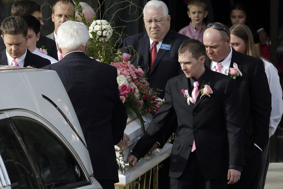 Photo - The casket of 6-year-old Emilie Parker is carried following funeral services on Saturday, Dec. 22, 2012, in Ogden, Utah. Emilie, whose family has Ogden roots, was one of the victims killed in a Dec. 14 mass shooting at Sandy Hook Elementary in Newtown, Conn. (AP Photo/Rick Bowmer) ORG XMIT: UTRB101