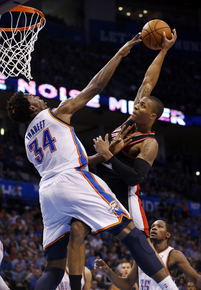 Oklahoma City Thunder\'s Hasheem Thabeet (34) blocks a shot attempt by Portland Trail Blazers\' Damian Lillard as the Oklahoma City Thunder defeat the Portland Trail Blazers 106-92 in NBA basketball at the Chesapeake Energy Arena in Oklahoma City, on Friday, Nov. 2, 2012. Photo by Steve Sisney, The Oklahoman