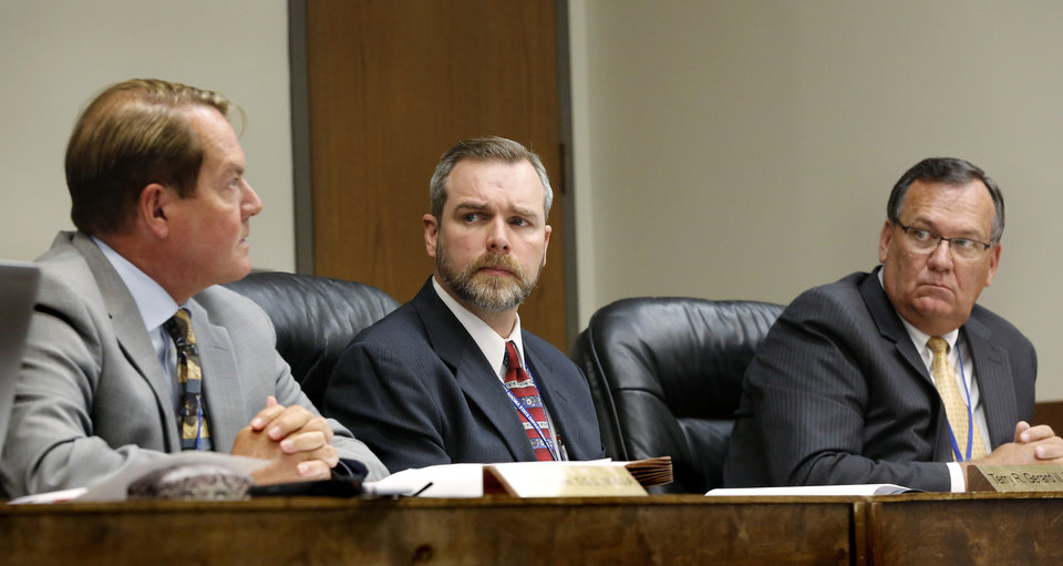 Photo - From left are Dr. Charles Grim, Dr. Terry R. Gerard II and Charles E. Skillings. The Oklahoma State Department of Health voted at their monthly meeting Tuesday morning, July 10, 2018, to ban sales of smokeable forms of medical marijuana and to require dispensaries to hire a pharmacist. The Board of Health voted on 75 pages of rules creating a rough framework for patients, physicians, caretakers and business owners interested in medical marijuana. The ban on sales of leaves and flowers for smoking and the requirement to hire a pharmacist weren't in the draft rules presented to the board, but were a priority of a coalition of medical groups. Julie Ezell, the Health Department's general counsel, presented the rules to a packed board room and to members of the public watching in an overflow room and online. She cautioned board members that the two new rules they added might not be allowed under the state question, inviting a court challenge. Photo by Jim Beckel, The Oklahoman