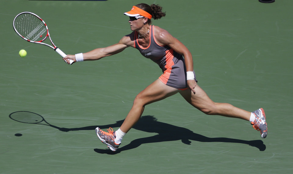 Photo -   Samantha Stosur, of Australia, returns a shot to Varvara Lepchenko in the third round of play at the 2012 US Open tennis tournament, Friday, Aug. 31, 2012, in New York. (AP Photo/Mike Groll)