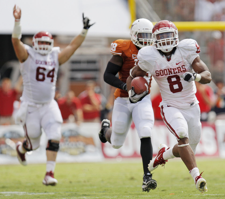 Photo - OU's Dominique Whaley (8) breaks away from UT's Emmanuel Acho (18) on a touchdown run as Gabe Ikard (64) celebrates in the background in the second half during the Red River Rivalry college football game between the University of Oklahoma Sooners (OU) and the University of Texas Longhorns (UT) at the Cotton Bowl in Dallas, Friday, Oct. 7, 2011. OU won, 55-17. Photo by Nate Billings, The Oklahoman