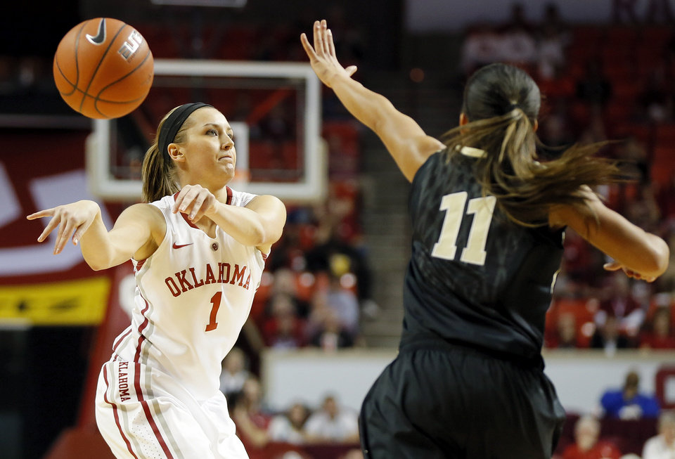 Photo - OU's Nicole Kornet (1) passes away from Vanderbilt's Jasmine Lister (11) in the first half during a women's college basketball game between the University of Oklahoma Sooners and the Vanderbilt Commodores at Lloyd Noble Center in Norman, Okla., Sunday, Dec. 16, 2012. Photo by Nate Billings, The Oklahoman