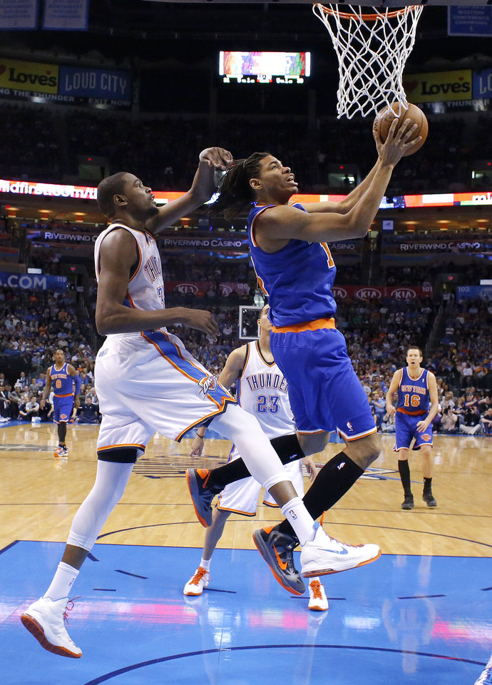 Photo - New YorK's Chris Copeland (14) shoots as Oklahoma City's Kevin Durant (35) defend during NBA basketball game between the Oklahoma City Thunder and the New York Knicks at the Chesapeake Energy Arena, Sunday, April 7, 2010, in Oklahoma City. Photo by Sarah Phipps, The Oklahoman