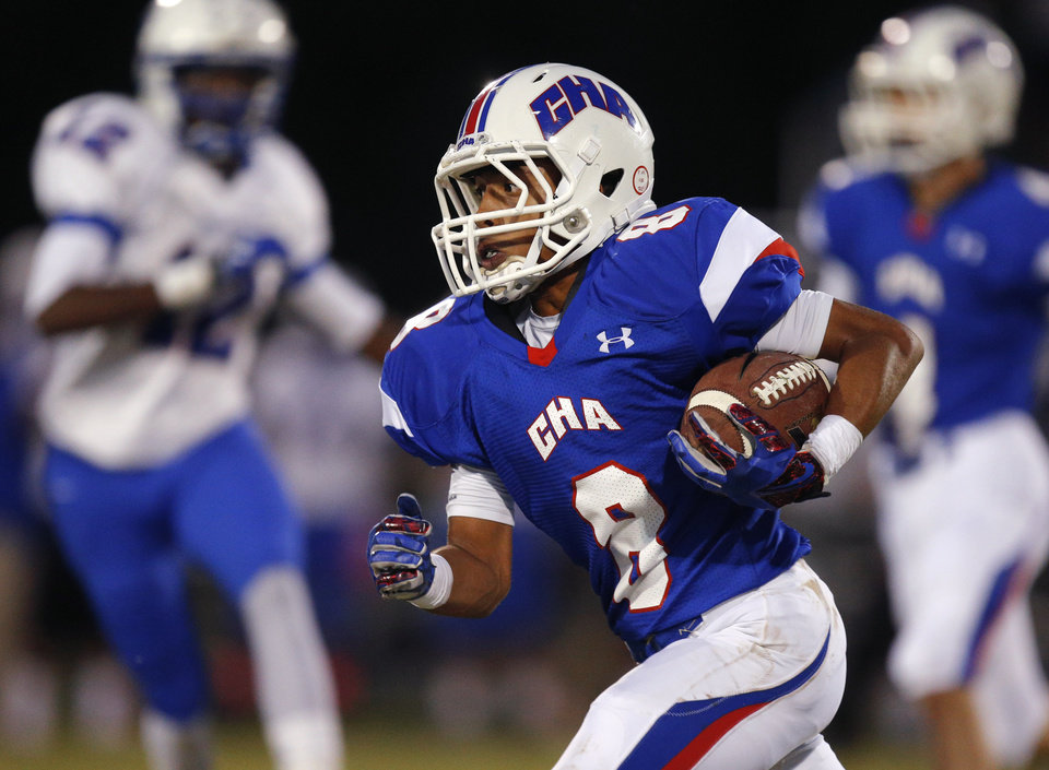 Christian Heritage Academy's Braden Mikes runs against Millwood during their high school football game at Christian Heritage in Oklahoma City, Friday, Oct. 4, 2013. Photo by Bryan Terry, The Oklahoman
