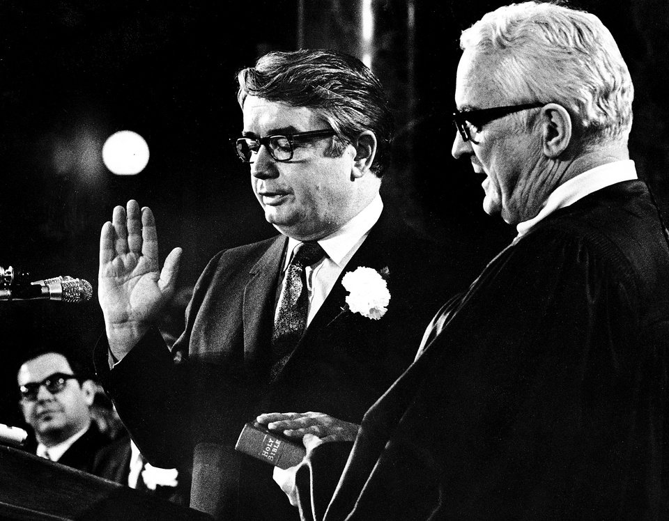 Photo - In this Jan. 4, 1971 photo, Patrick Lucey, center, is sworn in as Wisconsin Governor by Judge E. Harold Hallows, in Madison, Wis. Lucey, a hard-nosed Democratic politician who later became ambassador to Mexico, died Saturday, May 10, 2014. He was 96. (AP Photo/Wisconsin State Journal, Ed Stein)