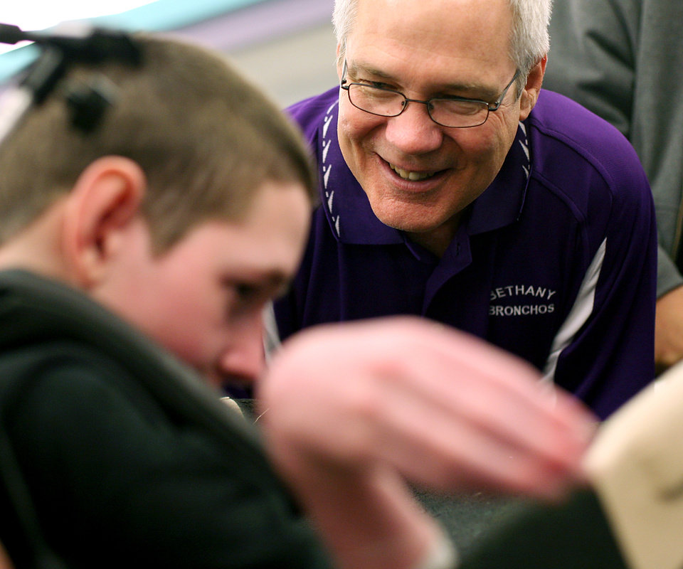 Photo - Bethany High School principal Don Wentroth talks with Chris Schatz during the Goodwill Games at The Children's Center in Bethany on Thursday, September 15, 2011. Photo by John Clanton, The Oklahoman ORG XMIT: KOD