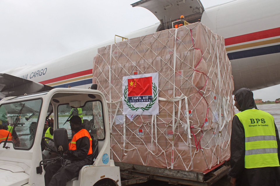 Photo - In this photo taken on Monday, Aug. 11 2014, workers unload Ebola related aid goods from China at the airport in Conakry, Guinea. Over the decades, Ebola cases have been confirmed in 10 African countries, including Congo where the disease was first reported in 1976. But until this year, Ebola had never come to West Africa. (AP Photo/ Youssouf Bah)