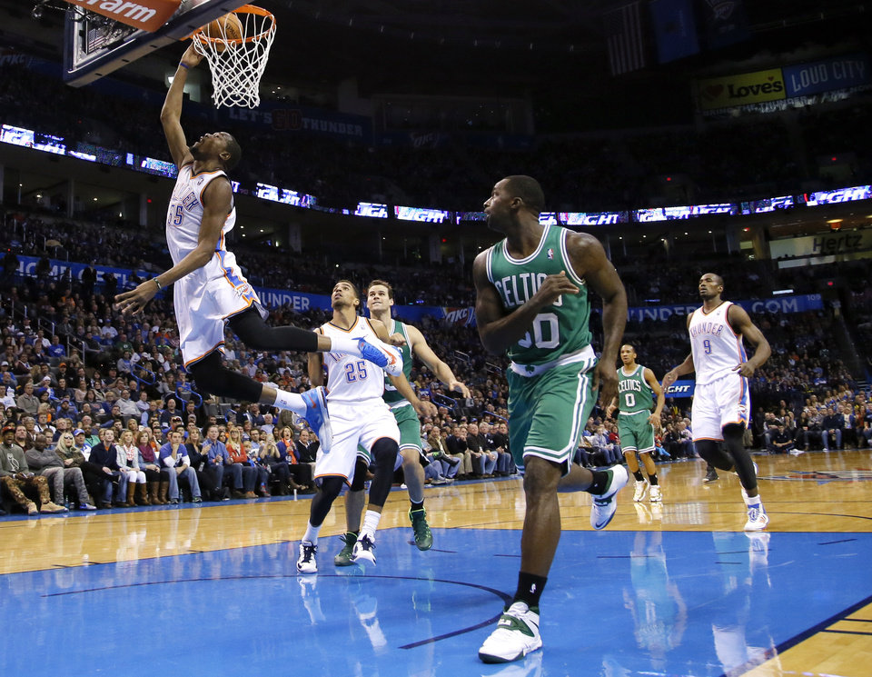 Photo - Oklahoma City's Kevin Durant (35) shoots a lay up as Boston's Brandon Bass (30) looks on during the NBA game between the Oklahoma City Thunder and the Boston Celtics at the Chesapeake Energy Arena., Sunday, Jan. 5, 2014. Photo by Sarah Phipps, The Oklahoman