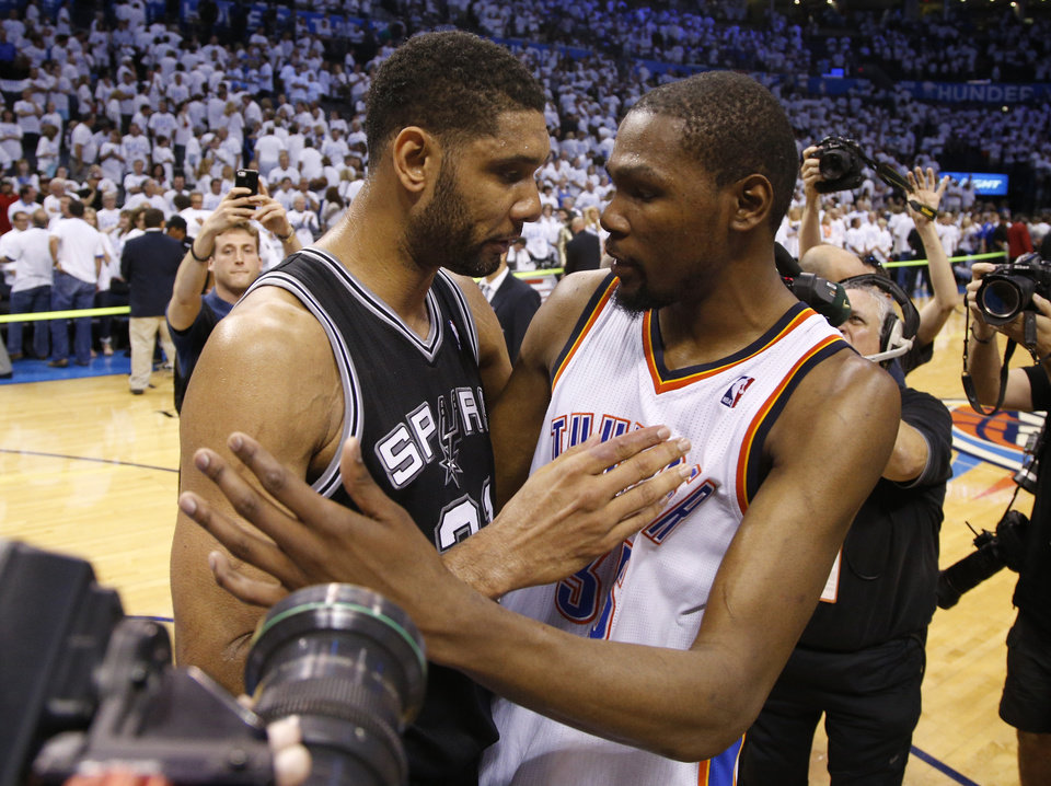 Photo - Oklahoma City's Kevin Durant (35) talks with San Antonio's Tim Duncan (21) during Game 6 of the Western Conference Finals in the NBA playoffs between the Oklahoma City Thunder and the San Antonio Spurs at Chesapeake Energy Arena in Oklahoma City, Saturday, May 31, 2014. Oklahoma City lost 112-107. Photo by Bryan Terry, The Oklahoman