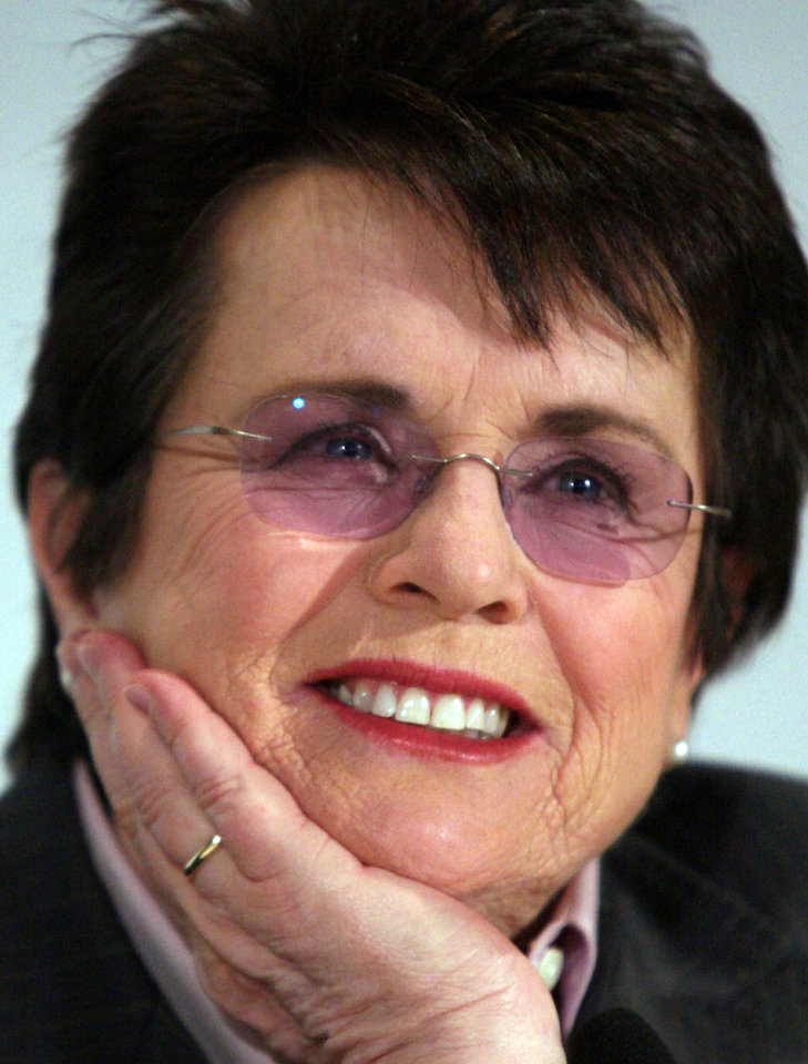 Photo - FILE - In this March 2, 2009 file photo, tennis great Billie Jean King listens during a news conference in New York. King believes standing up to discrimination is the best way to combat it. She will help lead the U.S. delegation in the opening ceremonies at the Sochi Olympics in Russia, which recently passed an anti-gay law. (AP Photos/Bebeto Matthews, File)