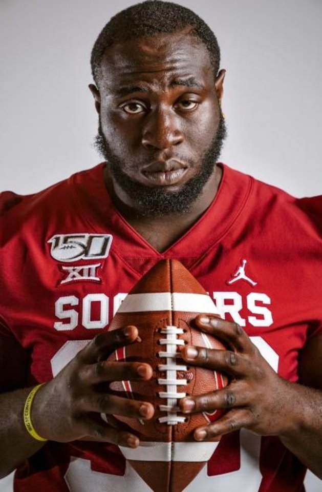 Photo -  Oklahoma defensive lineman Neville Gallimore was born in Ottawa, Canada, but is Jamaican by heritage. [Chris Landsberger/The Oklahoman]