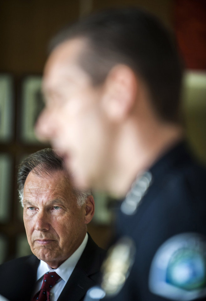 Photo - Orange County District Attorney Tony Rackauckas, left, watches as Irvine Police Chief David Maggard speaks after a hearing at the Santa Ana Courthouse in Santa Ana, Calif., Wednesday, July 10 2013. 42-year-old Saudi princess Meshael Alayban has been charged with human trafficking for allegedly holding a domestic worker against her will at a California condominium, prosecutors said. (AP Photo/The Orange County Register, Stuart Palley)   MAGS OUT; LOS ANGELES TIMES OUT