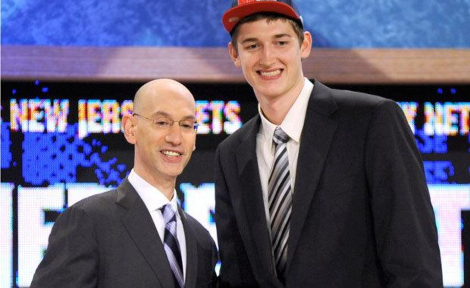 NBA deputy commissioner Adam Silver, left, poses with Tibor Pleiss, of Germany, Thursday, June 24, 2010 in New York.  (AP Photo/Bill Kostroun)