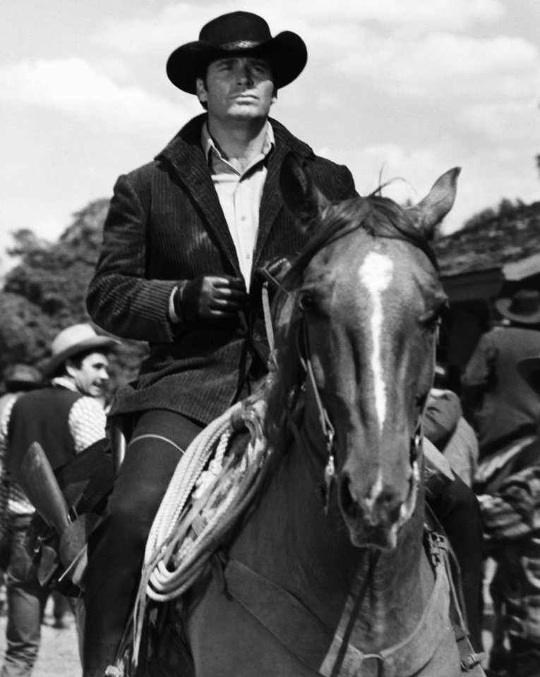 "Photo - FILE - James Garner as Australia- bound Jason McCullough rides into gold-rush boom town of Calendar in this April 1968 file photo taken at MGM Studios. Actor James Garner, wisecracking star of TV's ""Maverick"" who went on to a long career on both small and big screen, died Saturday July 19, 2014 according to Los angeles police. He was 86.(AP Photo/File)"