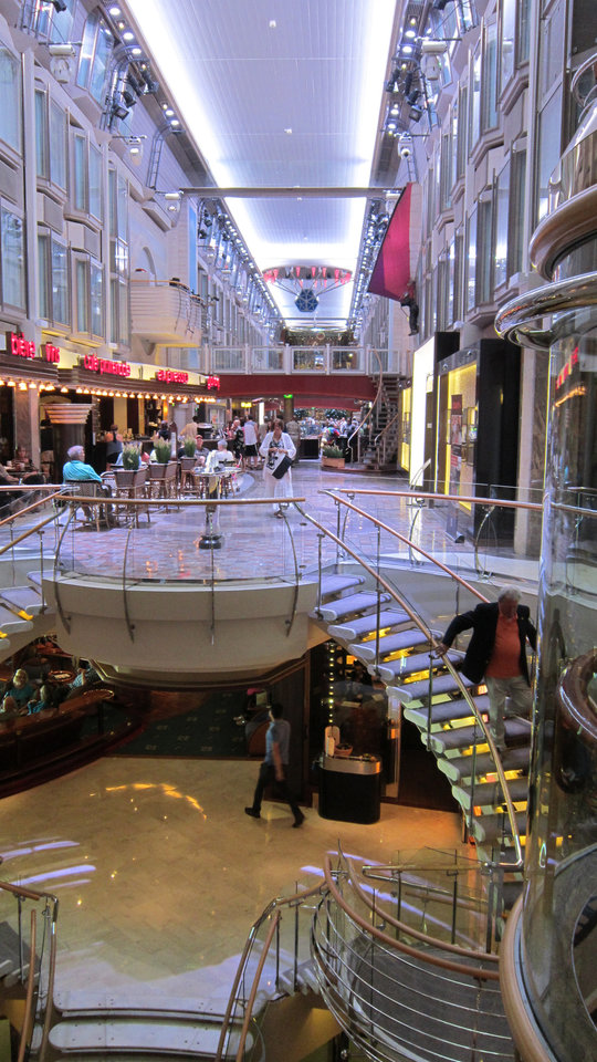 Photo -  The Royal Promenade, a four-story atrium that provides duty-free shops, a 24-hour cafe, pub, wine bar, live music and parades.   Picasa -  Richard Darnell