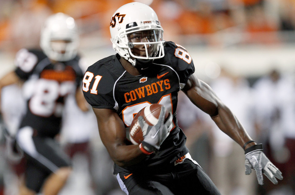 Photo - OSU's Justin Blackmon runs for a touchdown after catching a pass during the college football game between Texas A&M University and Oklahoma State University (OSU) at Boone Pickens Stadium in Stillwater, Okla., Thursday, Sept. 30, 2010. Photo by Bryan Terry, The Oklahoman