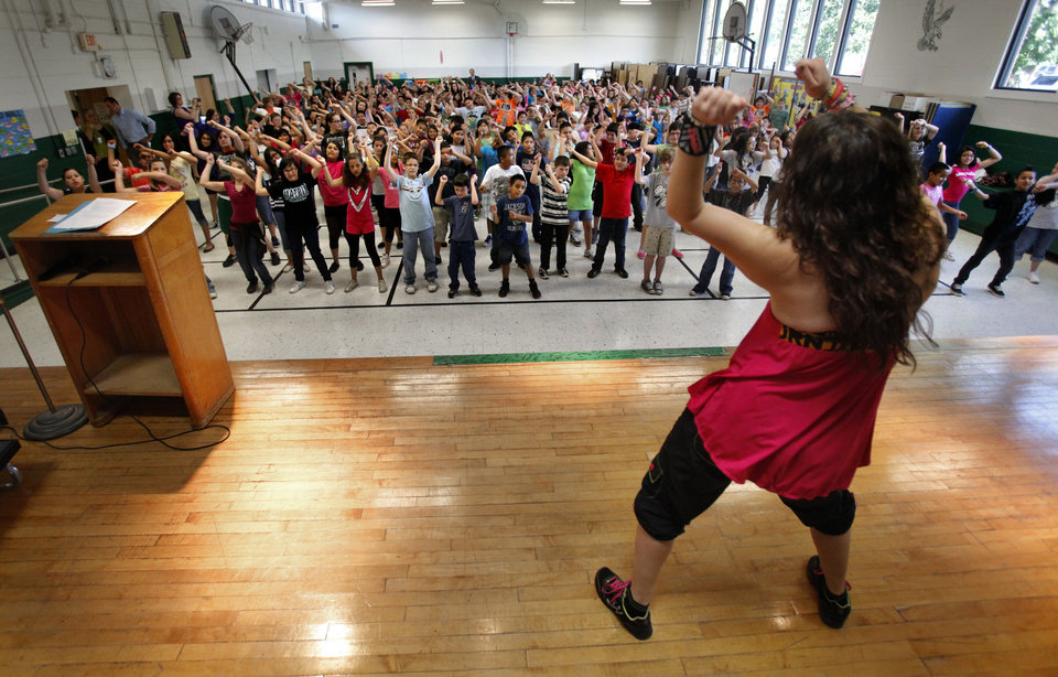Fillmore Elementary School students exercise Wednesday in the cafeteria with volunteer Zumba fitness instructor Lisa Dunsmore as part of a worldwide exercise event in Oklahoma City.  Photo by Steve Sisney, The Oklahoman