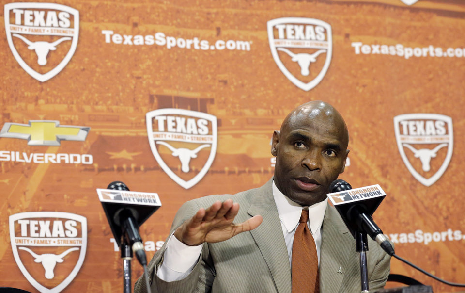 Charlie Strong answers questions during an NCAA college football news conference where Strong was introduced as the new Texas football coach, Monday, Jan. 6, 2014, in Austin, Texas. Strong replaces Mack Brown, who coached Texas for 16 years and won the 2005 national championship.