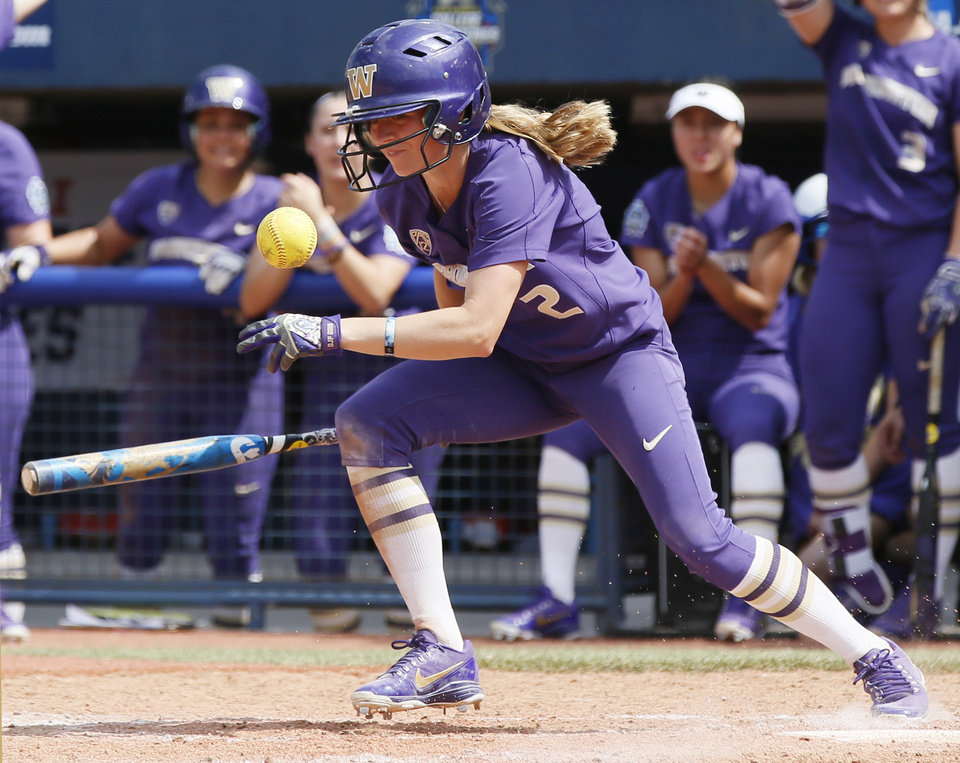Photo - Washington's Trysten Melhart (2) bunts for a single in the top of the sixth inning during the second game of the Women's College World Series between the Oklahoma Sooners (OU) and Washington Huskies at USA Softball Hall of Fame Stadium in Oklahoma City, Thursday, May 31, 2018. Washington won 2-0. Photo by Nate Billings, The Oklahoman