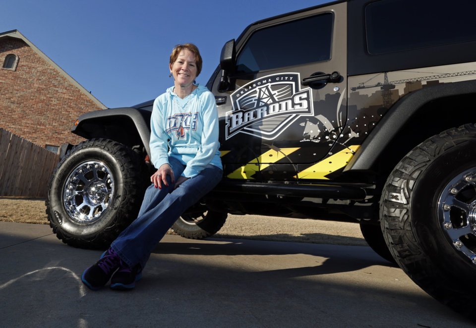 Photo - Above, left:  Cynthia Hughes shows the $40,000 Jeep Wrangler she won from the Barons in December 2012.    Photo by Steve Sisney, The Oklahoman  STEVE SISNEY -