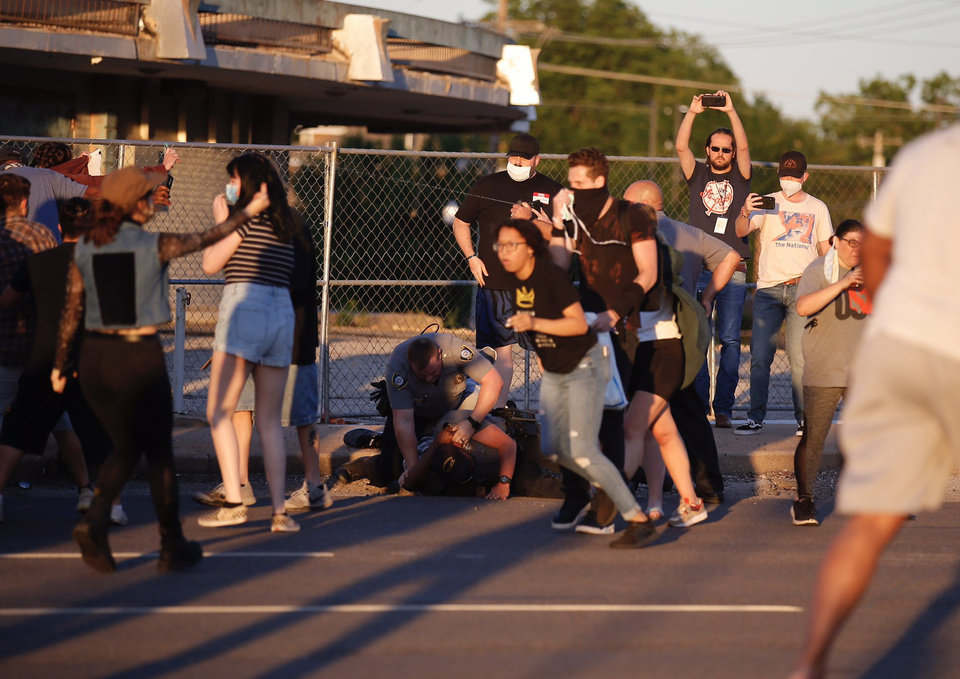 Photo - Oklahoma City Police arrest an alleged agitator during a protest Saturday, May 30, 2020, near NW 23rd in Oklahoma City. Photo by Sarah Phipps