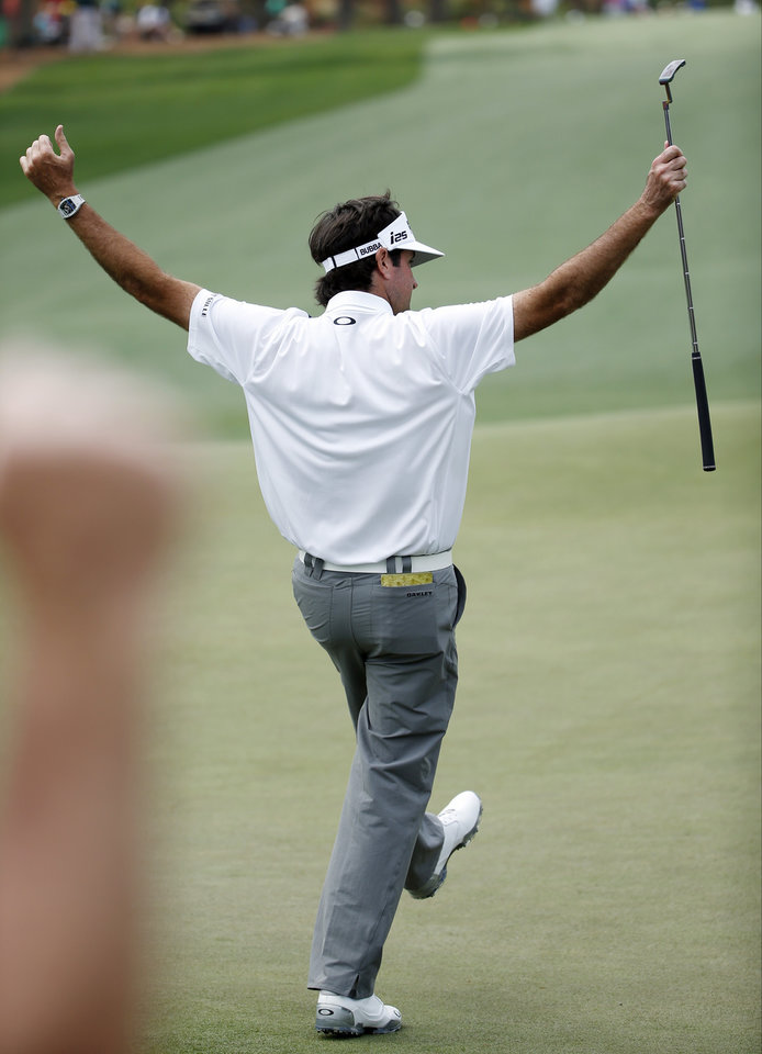 Photo - Bubba Watson celebrates after a birdie on the 14th green during the second round of the Masters golf tournament Friday, April 11, 2014, in Augusta, Ga. (AP Photo/Matt Slocum)