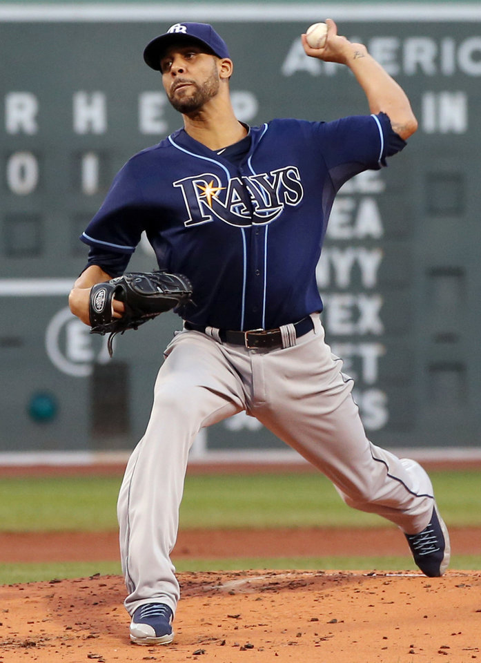 Photo - Tampa Bay Rays starting pitcher David Price delivers to the Boston Red Sox during the first inning of a baseball game at Fenway Park in Boston on Wednesday, July 24, 2013. (AP Photo/Elise Amendola)